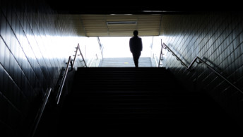 Exit and silhouette of a commuter
