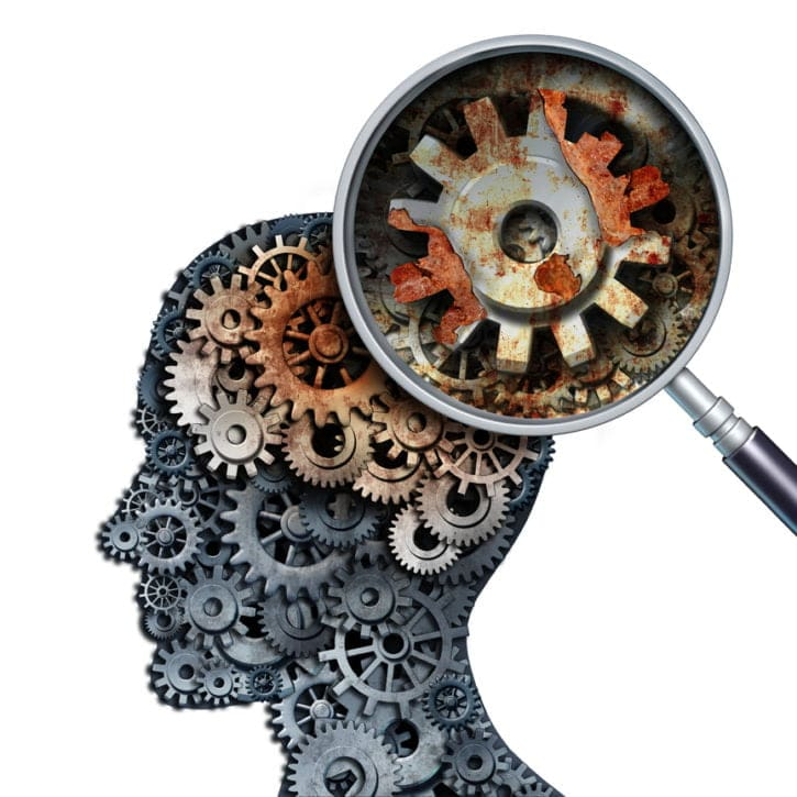 Brain decline and dementia or aging as memory loss concept for brain cancer decay or an Alzheimer's disease with the medical icon of a old rusting mechanical gears and cog wheels of metal in the shape of a human head with rust.