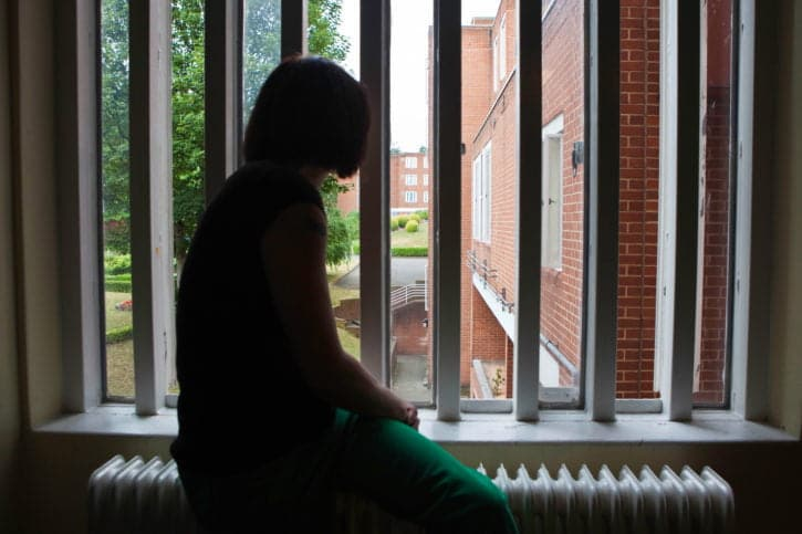 Prisoner looking out her cell window