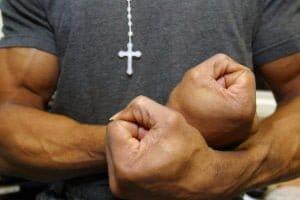 A prisoner flexes his muscles. HMP Wandsworth