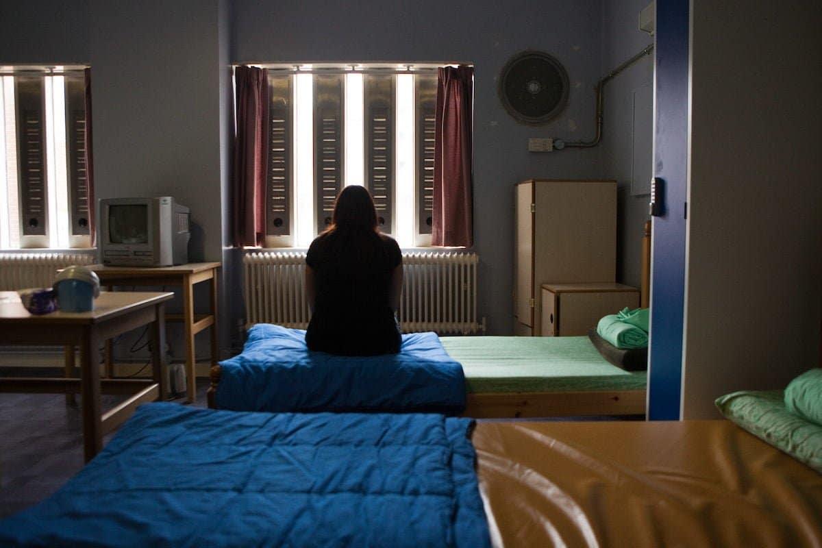 woman prisoner on bunk