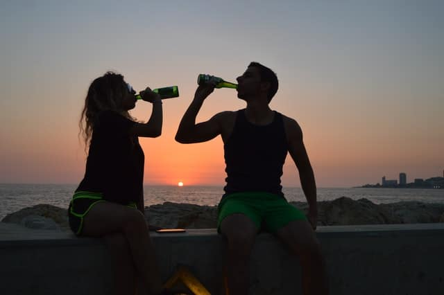 man and woman drinking