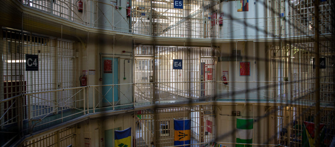 A view of the landings of C wing and E wing from the central star at HMP Pentonville, London, UK.