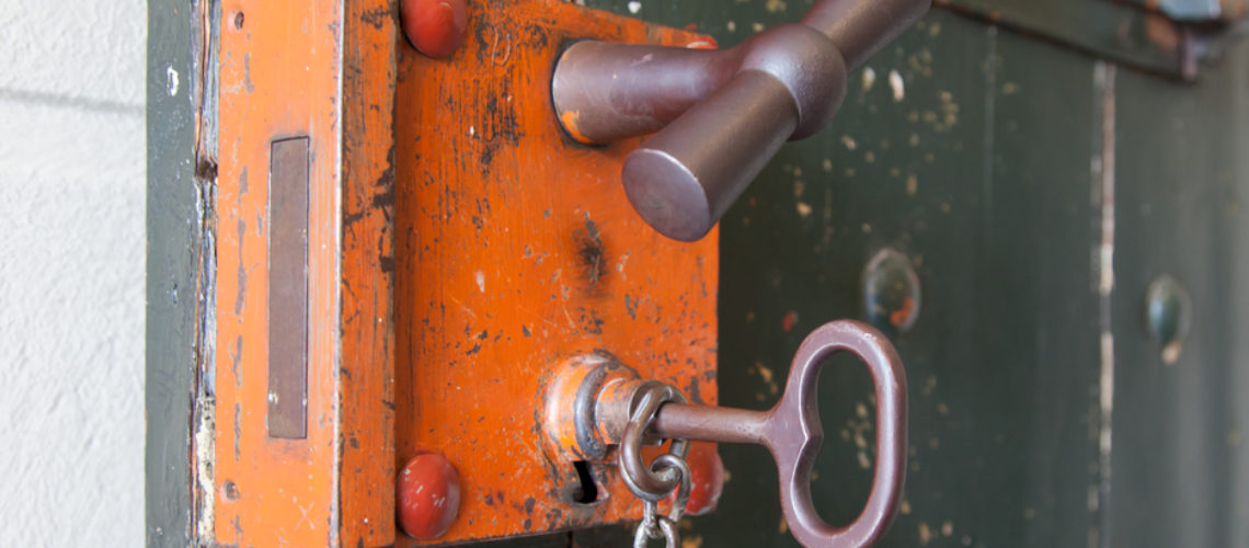 Old lock in a prison, selective focus
