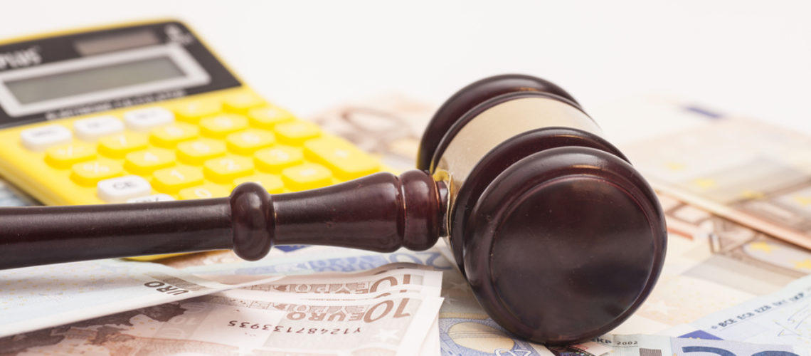 Judge gavel, euro banknotes and calculator