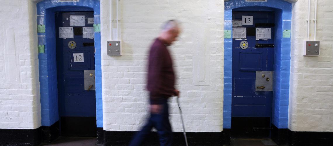 An older prisoner walks along the corridor of the Vulnerable Prisoners Unit. HMP Wandsworth, London, United Kingdom