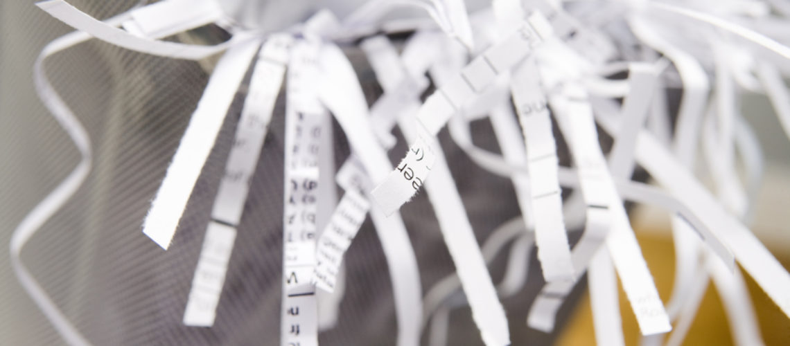 Close-Up Of An Overflowing Paper Shredder