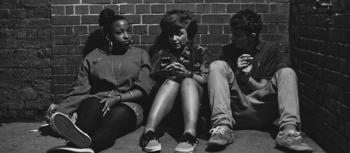 young-people-sitting-agains